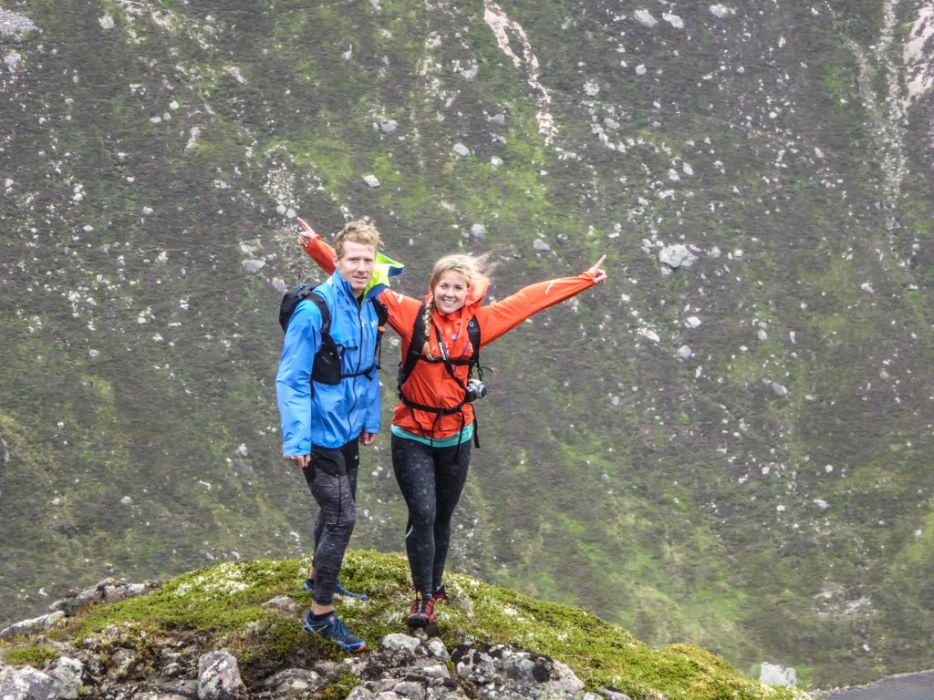 Couple pose for photo during climb