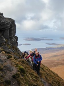 Group of four hike Scotland's mountains