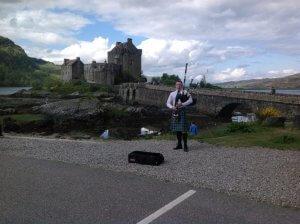 piper at Eilean Donan